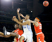Tyler Roberson of the Syracuse Orange and DaJuan Coleman defend a shot by Kennedy Meeks of the North Carolina Tar Heels in the second half during the...