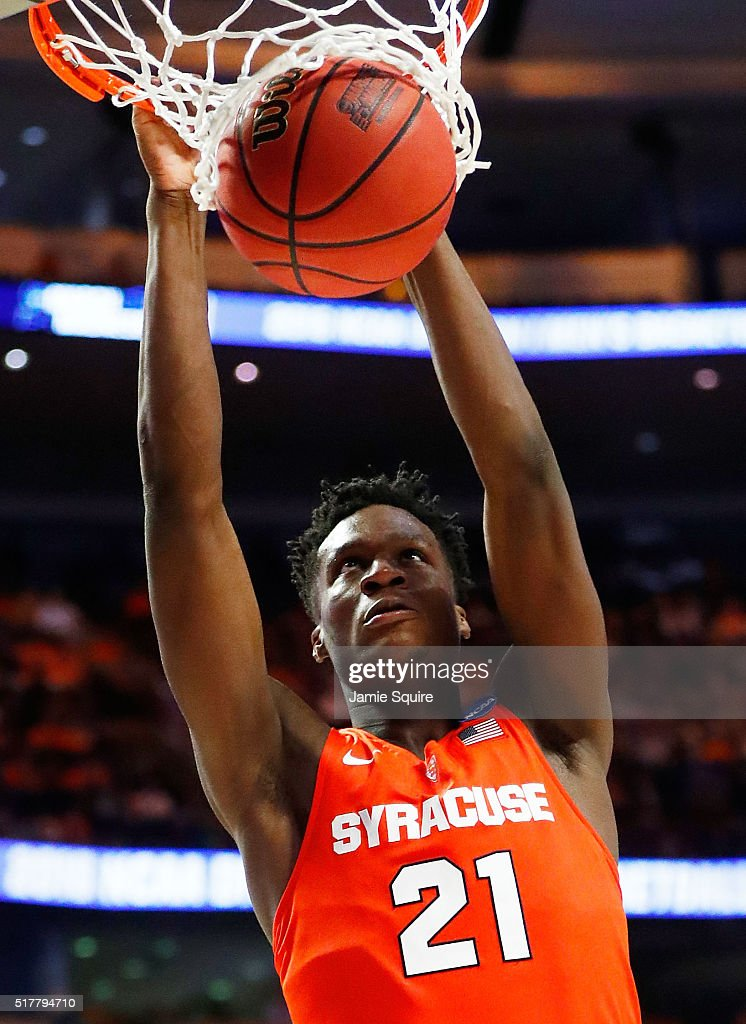 Tyler Roberson of the Syracuse Orange dunks in the second half against the Virginia Cavaliers during the 2016 NCAA Men's Basketball Tournament...