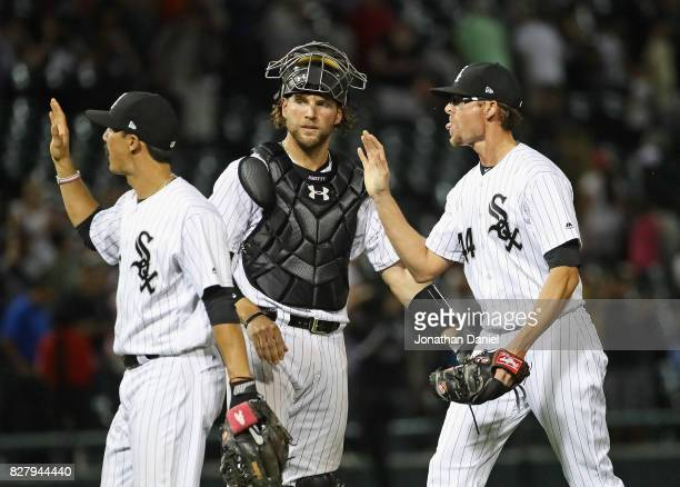 Tyler Saladino Kevan Smith and Tyler Clippard of the Chicago White Sox celebrate a win over the Houston Astros at Guaranteed Rate Field on August 8...