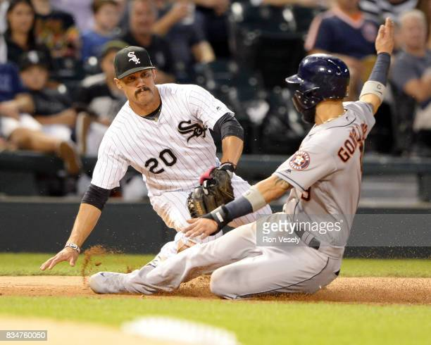 Tyler Saladino of the Chicago White Sox applies the tag late as Marwin Gonzalez of the Houston Astros slides safely into third base on August 8 2017...