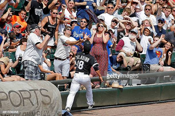 Tyler Saladino of the Chicago White Sox attempts to make a catch in the stands against the Kansas City Royals during the seventh inning at US...