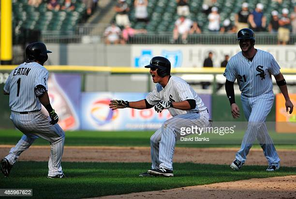 Tyler Saladino of the Chicago White Sox celebrates his game winning single against the Seattle Mariners on August 30 2015 at US Cellular Field in...