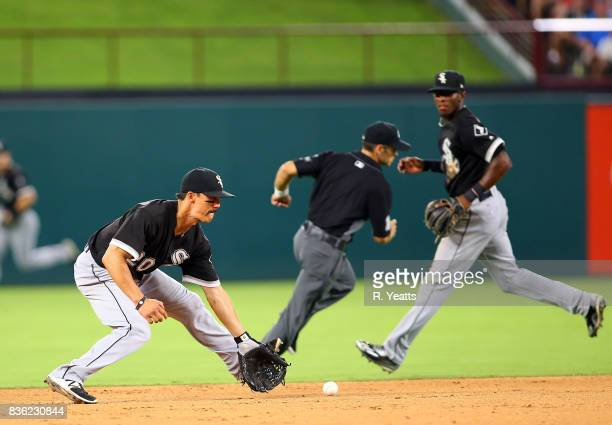 Tyler Saladino of the Chicago White Sox fields a ground ball in the sixth inning against the Texas Rangers at Globe Life Park in Arlington on August...