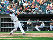 Tyler Saladino of the Chicago White Sox hits a game winning single against the Seattle Mariners on August 30 2015 at US Cellular Field in Chicago...