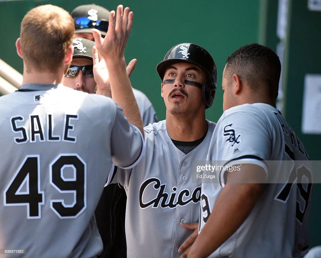 Tyler Saladino #18 of the Chicago White Sox is congratulated by <a gi-track='captionPersonalityLinkClicked' href=/galleries/search?phrase=Chris+Sale&family=editorial&specificpeople=7132181 ng-click='$event.stopPropagation()'>Chris Sale</a> #49 and Jose Abreu #79 after scoring on an Austin Jackson single in the fifth inning against the Kansas City Royals at Kauffman Stadium on May 29, 2016 in Kansas City, Missouri.