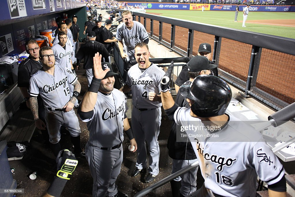 Tyler Saladino #18 of the Chicago White Sox is congratulated by team mates as he returns to the dugout after hitting a two run homer in the eighth inning during the Chicago White Sox Vs New York Mets regular season MLB game at Citi Field on May 31, 2016 in New York City.