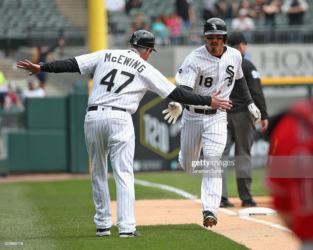 Tyler Saladino #18 of the Chicago White Sox is congratulated by third base coach Joe McEwing #47 after hitting a solo home run in the 1st inning against the Los Angeles Angels at U.S. Cellular Field on April 20, 2016 in Chicago, Illinois.