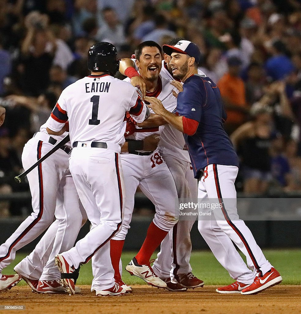 Tyler Saladino #18 of the Chicago White Sox (center) is mobbed by teammates including Adam Eaton #1 after getting the game-winning hit, a single in the 9th inning, against the Chicago Cubs at U.S. Cellular Field on July 25, 2016 in Chicago, Illinois. The White Sox defeated the Cubs 5-4.