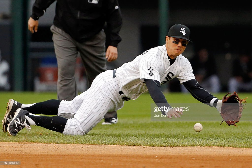 Tyler Saladino #18 of the Chicago White Sox is unable to field a ball against the Detroit Tigers during the ninth inning at U.S. Cellular Field on October 4, 2015 in Chicago, Illinois.