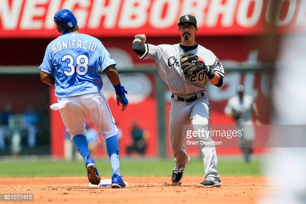 Tyler Saladino of the Chicago White Sox makes a double play against Jorge Bonifacio of the Kansas City Royals during the first inning at Kauffman...