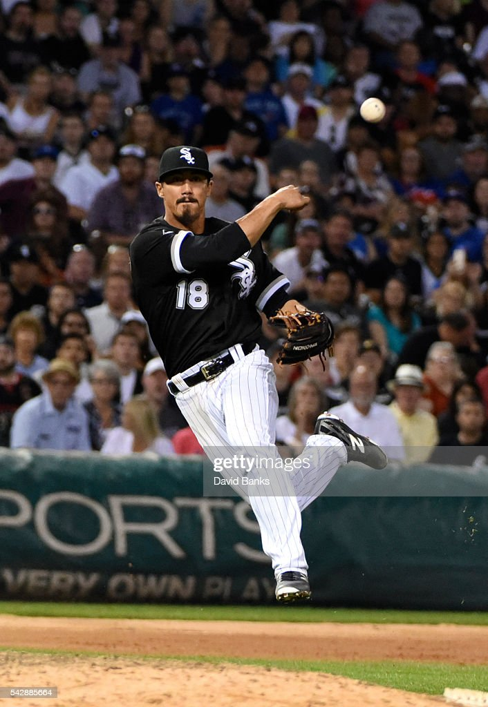 Tyler Saladino #18 of the Chicago White Sox makes a play on Edwin Encarnacion #10 of the Toronto Blue Jays during the fifth inning on June 24, 2016 at U. S. Cellular Field in Chicago, Illinois.