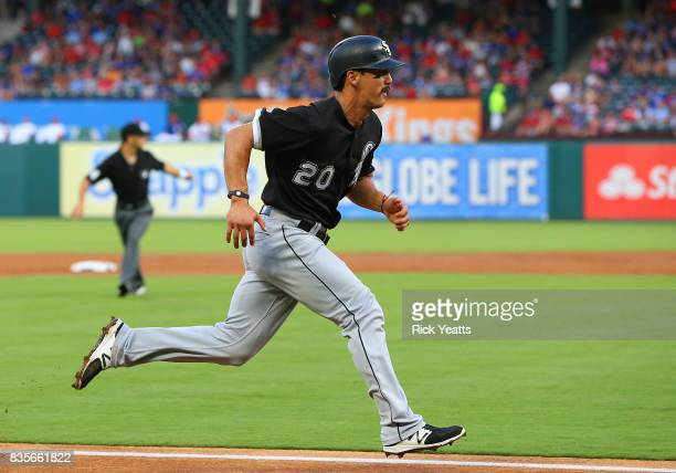 Tyler Saladino of the Chicago White Sox run in to score in the first inning against the Texas Rangers at Globe Life Park in Arlington on August 19...