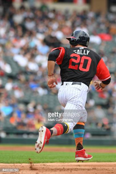 Tyler Saladino of the Chicago White Sox runs the bases while wearing a special uniform with his nickname Sally on the back to celebrate Players...