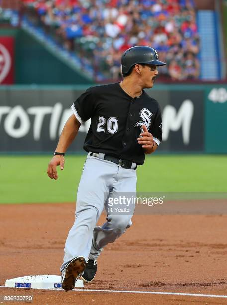 Tyler Saladino of the Chicago White Sox safe at third base in the first inning against the Texas Rangers at Globe Life Park in Arlington on August 19...