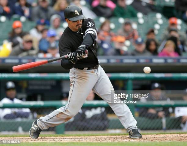 Tyler Saladino of the Chicago White Sox singles against the Detroit Tigers during the ninth inning at Comerica Park on April 29 2017 in Detroit...