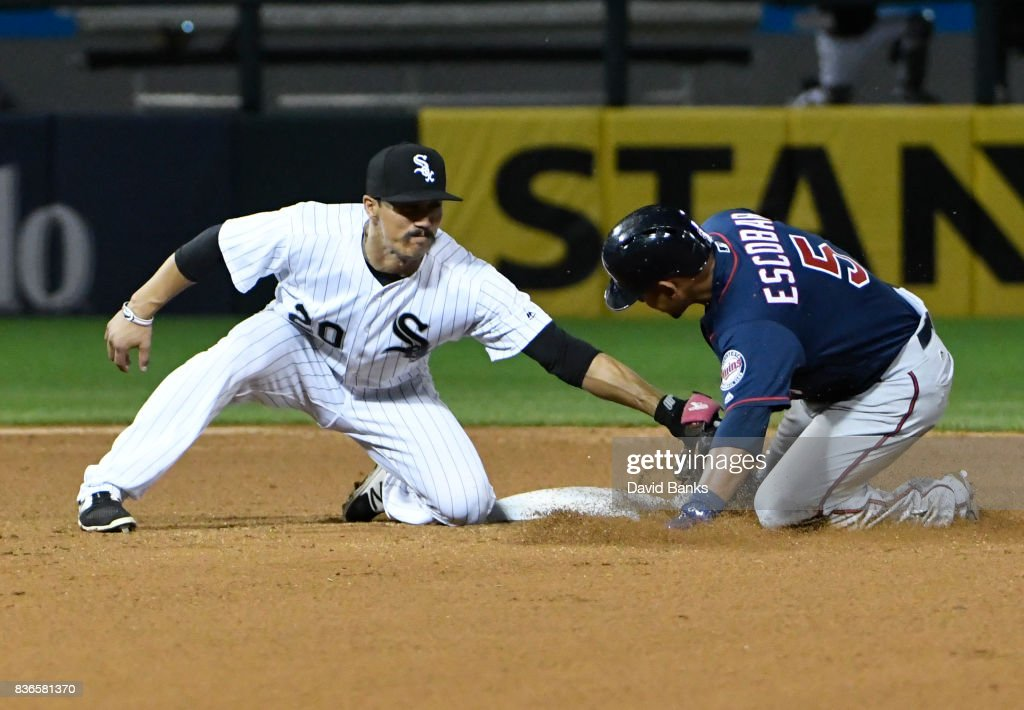 Tyler Saladino #20 of the Chicago White Sox tags out Eduardo Escobar #5 of the Minnesota Twins at second base during the fifth inning in game two of a doubleheader on August 21, 2017 at Guaranteed Rate Field in Chicago, Illinois.