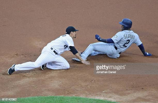Tyler Saladino of the Chicago White Sox tags out Jean Segura of the Seattle Mariners at second base in the 1st inning at Guaranteed Rate Field on...
