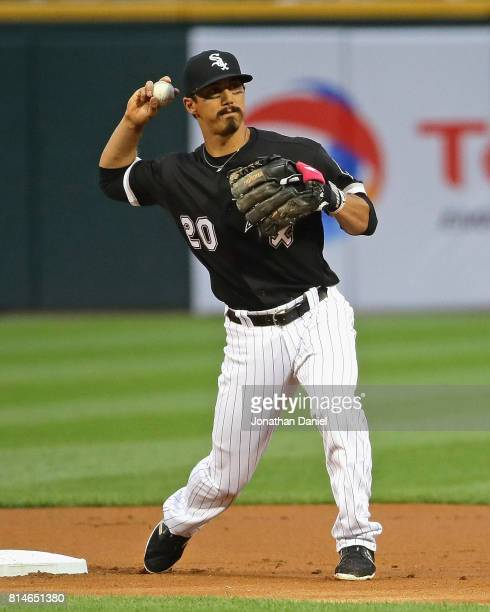 Tyler Saladino of the Chicago White Sox turns a double play in the 1st inning against the Seattle Mariners at Guaranteed Rate Field on July 14 2017...