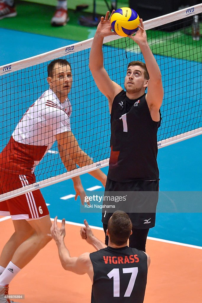 Tyler Sanders #1 of Canada tosses the ball during the Men's World Olympic Qualification game between Poland and Canada at Tokyo Metropolitan Gymnasium on May 28, 2016 in Tokyo, Japan.