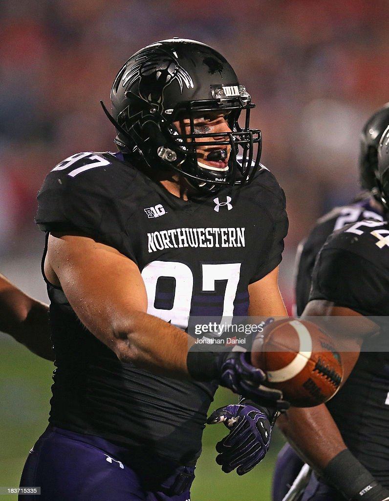 Tyler Scott #97 of the Northwestern Wildcats celebrates recovering a fumble against the Ohio State Buckeyes at Ryan Field on October 5, 2013 in Evanston, Illinois. Ohio State defeated Northwestern 40-30.