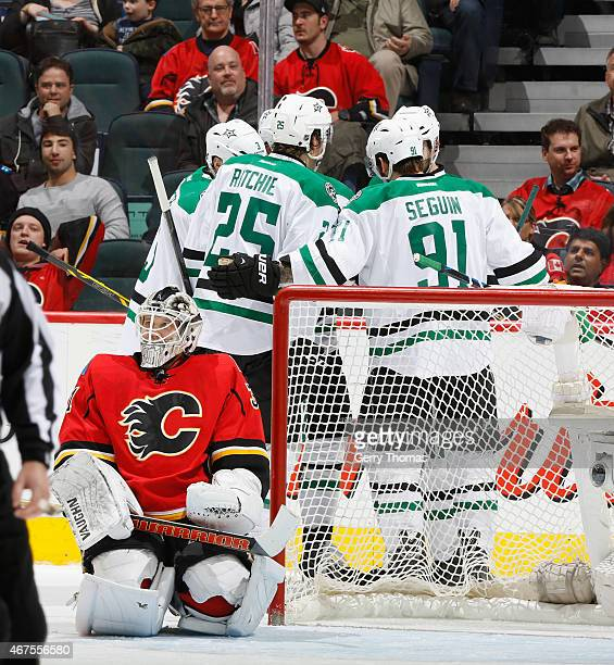 Tyler Seguin and Brett Ritchie of the Dallas Stars celebrate with teammates after a goal against the Calgary Flames at Scotiabank Saddledome on March...