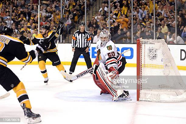 Tyler Seguin and Daniel Paille of the Boston Bruins react after a goal in the first period by Rich Peverley against Corey Crawford of the Chicago...
