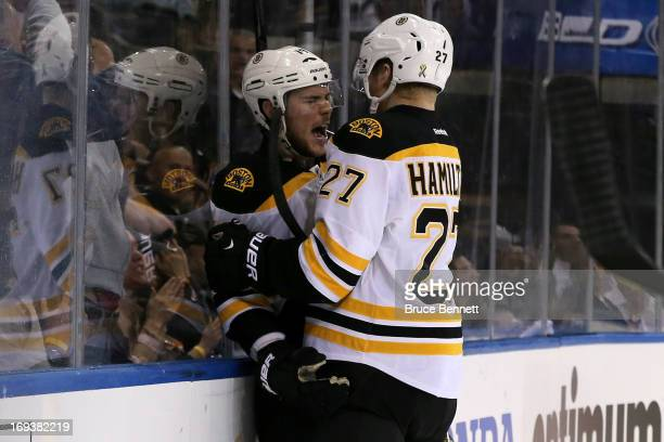 Tyler Seguin and Dougie Hamilton of the Boston Bruins celebrate after Seguin scored a goal in the third period against the New York Rangers in Game...