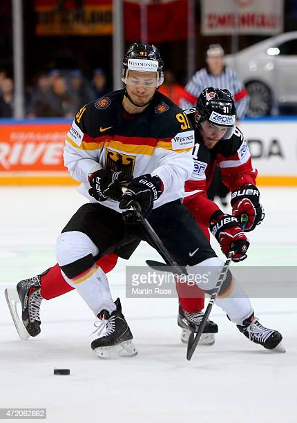 Tyler Seguin of Canada and Moritz Mueller of Germany battle for the puck during the IIHF World Championship group A match between Canada and Germany...