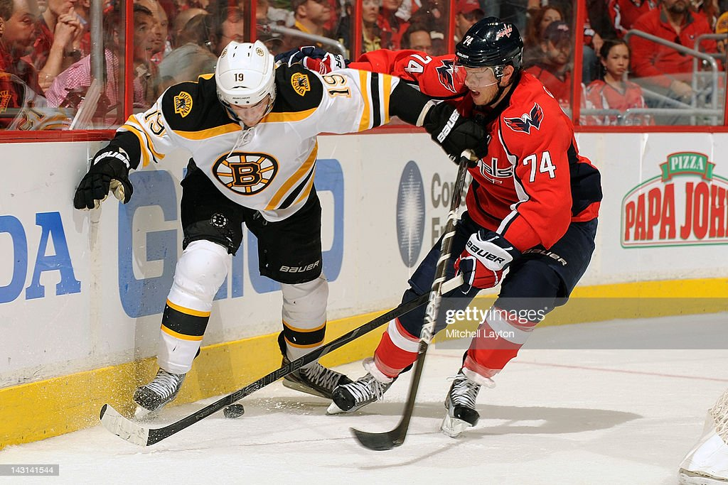 <a gi-track='captionPersonalityLinkClicked' href=/galleries/search?phrase=Tyler+Seguin&family=editorial&specificpeople=6698848 ng-click='$event.stopPropagation()'>Tyler Seguin</a> #19 of the Boston Bruins and John Carlson #74 of the Washington Capitals fight for a loose puck during Game Four of the Eastern Conference Quarterfinals of the 2012 NHL Stanley Cup Playoffs on April 19, 2012 at the Verizon Center in Washington, DC.