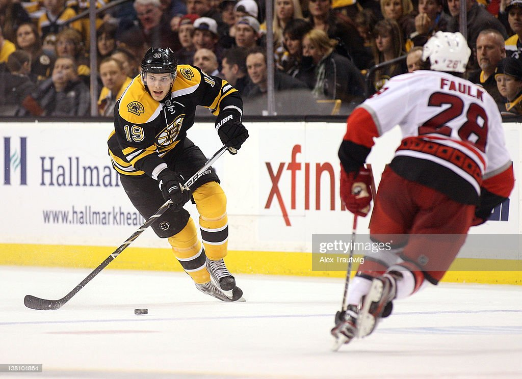 <a gi-track='captionPersonalityLinkClicked' href=/galleries/search?phrase=Tyler+Seguin&family=editorial&specificpeople=6698848 ng-click='$event.stopPropagation()'>Tyler Seguin</a> #19 of the Boston Bruins brings the puck up the ice against Justin Faulk #28 of the Carolina Hurricanes at TD Garden on February 2, 2012 in Boston, Massachusetts. The Hurricanes defeated the Bruins 3-0.
