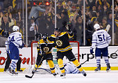 Tyler Seguin of the Boston Bruins celebrates following teammate Patrice Bergeron's of the Boston Bruins gamewinning goal in overtime against the...