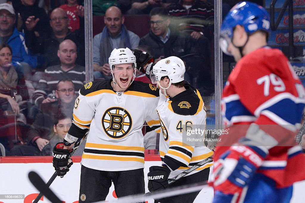 <a gi-track='captionPersonalityLinkClicked' href=/galleries/search?phrase=Tyler+Seguin&family=editorial&specificpeople=6698848 ng-click='$event.stopPropagation()'>Tyler Seguin</a> #19 of the Boston Bruins celebrates his third-period goal with teammate <a gi-track='captionPersonalityLinkClicked' href=/galleries/search?phrase=David+Krejci&family=editorial&specificpeople=722556 ng-click='$event.stopPropagation()'>David Krejci</a> #46 during the NHL game against the Montreal Canadiens at the Bell Centre on February 6, 2013 in Montreal, Quebec, Canada. The Bruins defeated the Canadiens 2-1.
