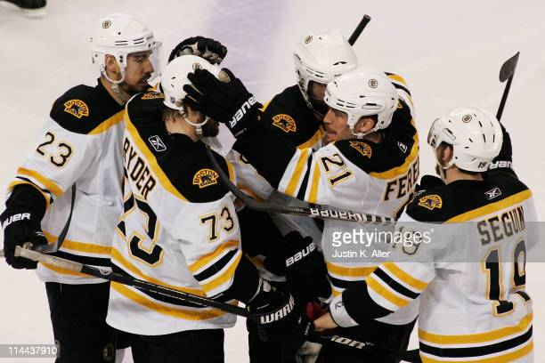 Tyler Seguin of the Boston Bruins celebrates with his teammates after scoring a third period goal against the Tampa Bay Lightning in Game Three of...