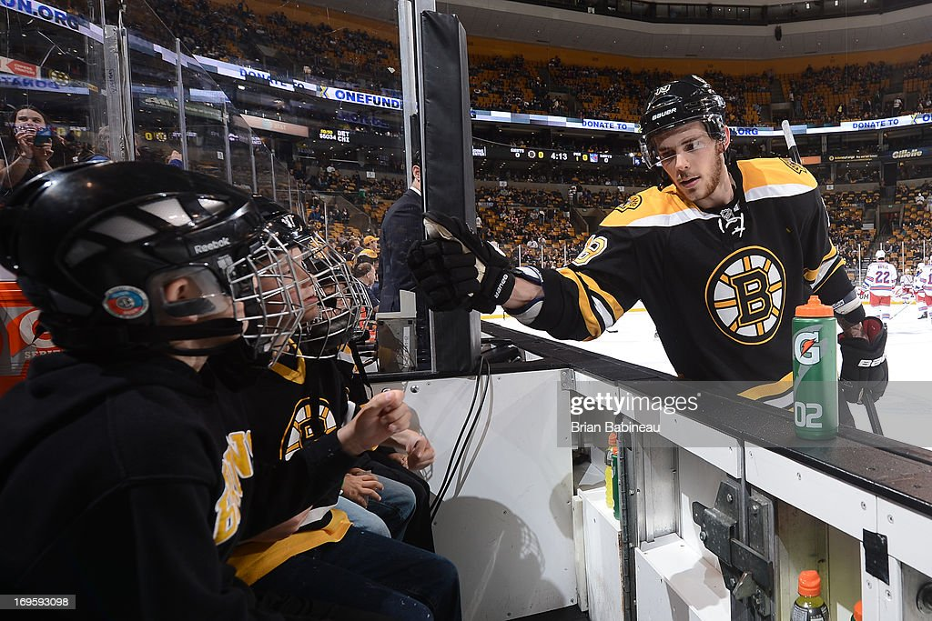 Tyler Seguin #19 of the Boston Bruins fist bumps the bench kids during warm ups prior to the game against the New York Rangers in Game Five of the Eastern Conference Semifinals during the 2013 NHL Stanley Cup Playoffs at TD Garden on May 25, 2013 in Boston, Massachusetts.