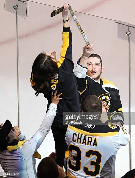 Tyler Seguin of the Boston Bruins hands his stick to a young fan after their 6 to 5 win over the Tampa Bay Lightning in Game Two of the Eastern...