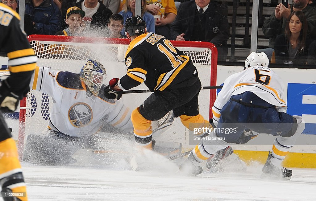 <a gi-track='captionPersonalityLinkClicked' href=/galleries/search?phrase=Tyler+Seguin&family=editorial&specificpeople=6698848 ng-click='$event.stopPropagation()'>Tyler Seguin</a> #19 of the Boston Bruins scores a goal against <a gi-track='captionPersonalityLinkClicked' href=/galleries/search?phrase=Jhonas+Enroth&family=editorial&specificpeople=570456 ng-click='$event.stopPropagation()'>Jhonas Enroth</a> #1 of the Buffalo Sabres at the TD Garden on April 7, 2012 in Boston, Massachusetts.