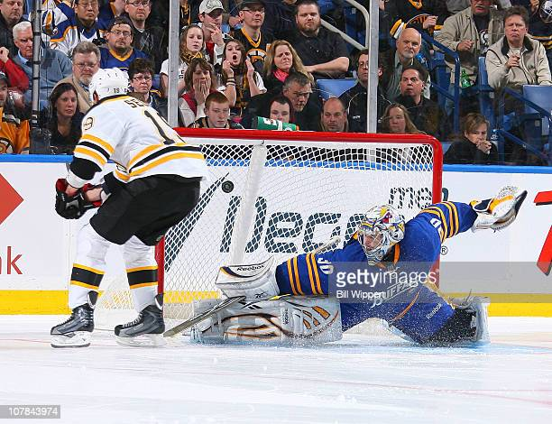 Tyler Seguin of the Boston Bruins scores a goal in the shootout against Ryan Miller of the Buffalo Sabres at HSBC Arena on January 1 2011 in Buffalo...