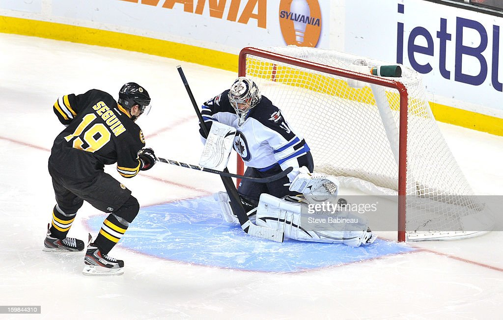 <a gi-track='captionPersonalityLinkClicked' href=/galleries/search?phrase=Tyler+Seguin&family=editorial&specificpeople=6698848 ng-click='$event.stopPropagation()'>Tyler Seguin</a> #19 of the Boston Bruins scores in a shoot out against Ondrej Pavelec #31 of the Winnipeg Jets at the TD Garden on January 21, 2013 in Boston, Massachusetts.