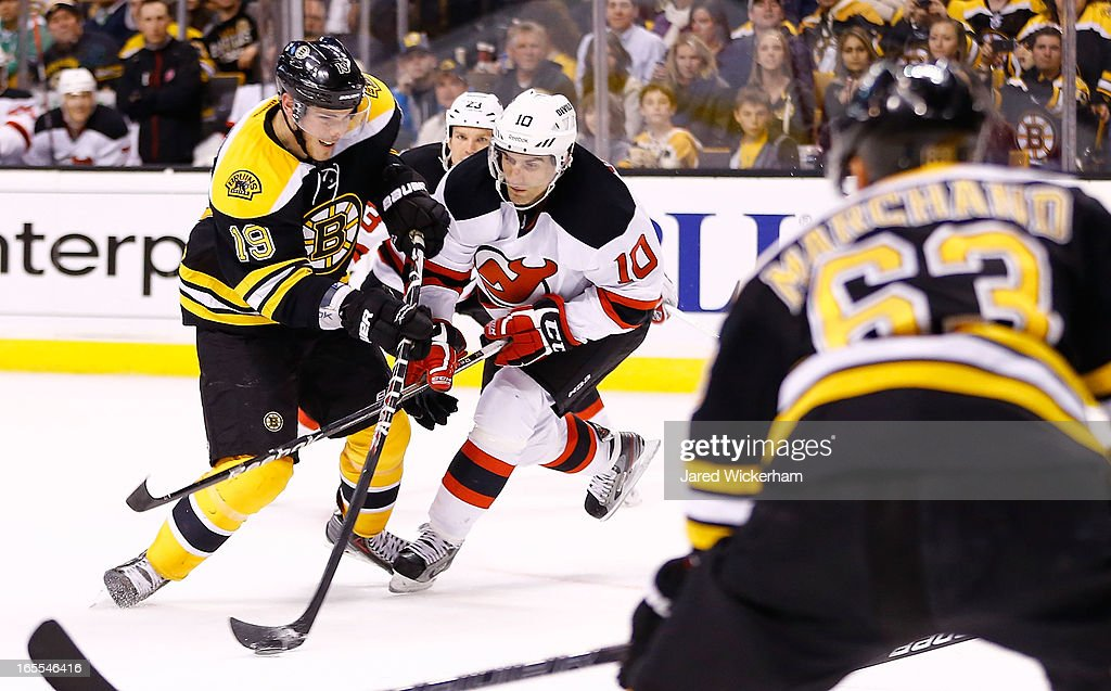 <a gi-track='captionPersonalityLinkClicked' href=/galleries/search?phrase=Tyler+Seguin&family=editorial&specificpeople=6698848 ng-click='$event.stopPropagation()'>Tyler Seguin</a> #19 of the Boston Bruins takes a shot in front of <a gi-track='captionPersonalityLinkClicked' href=/galleries/search?phrase=Peter+Harrold&family=editorial&specificpeople=579399 ng-click='$event.stopPropagation()'>Peter Harrold</a> #10 of the New Jersey Devils during the game on April 2, 2013 at TD Garden in Boston, Massachusetts.