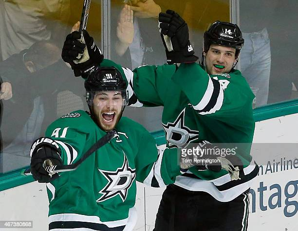 Tyler Seguin of the Dallas Stars and Jamie Benn of the Dallas Stars celebrate after the Stars score against the Buffalo Sabres in the third period at...