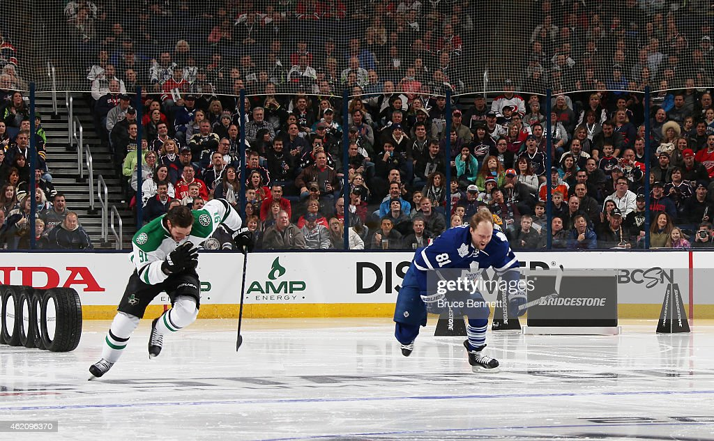 <a gi-track='captionPersonalityLinkClicked' href=/galleries/search?phrase=Tyler+Seguin&family=editorial&specificpeople=6698848 ng-click='$event.stopPropagation()'>Tyler Seguin</a> #91 of the Dallas Stars and Team Toews competes against <a gi-track='captionPersonalityLinkClicked' href=/galleries/search?phrase=Phil+Kessel&family=editorial&specificpeople=537794 ng-click='$event.stopPropagation()'>Phil Kessel</a> #81 of the Toronto Maple Leafs and Team Foligno during the Bridgestone NHL Fastest Skater event of the 2015 Honda NHL All-Star Skills Competition at Nationwide Arena on January 24, 2015 in Columbus, Ohio.