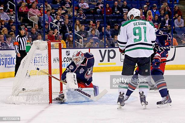 Tyler Seguin of the Dallas Stars beats Sergei Bobrovsky of the Columbus Blue Jackets for a goal during the first period on October 14 2014 at...