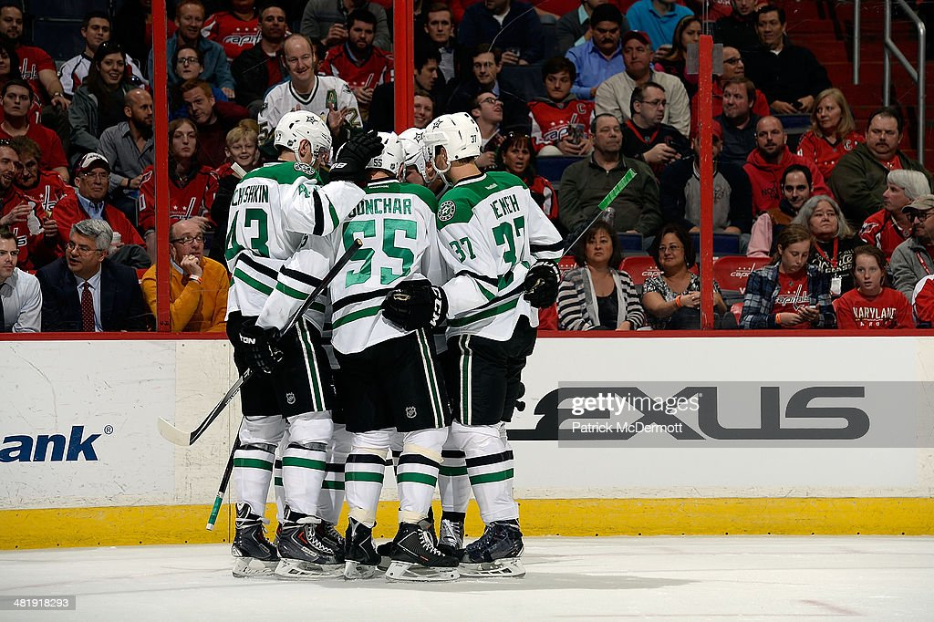 <a gi-track='captionPersonalityLinkClicked' href=/galleries/search?phrase=Tyler+Seguin&family=editorial&specificpeople=6698848 ng-click='$event.stopPropagation()'>Tyler Seguin</a> #91 of the Dallas Stars celebrates with his teammates after scoring a goal in the first period during an NHL game against the Washington Capitals at Verizon Center on April 1, 2014 in Washington, DC.