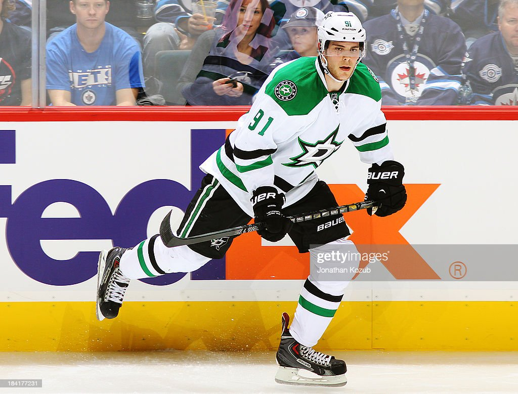 Tyler Seguin #91 of the Dallas Stars follows the play up the ice during second period action against the Winnipeg Jets at the MTS Centre on October 11, 2013 in Winnipeg, Manitoba, Canada.