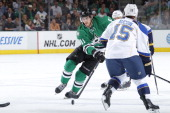 Tyler Seguin of the Dallas Stars handles the puck against Keith Aucoin at the American Airlines Center on April 11 2014 in Dallas Texas