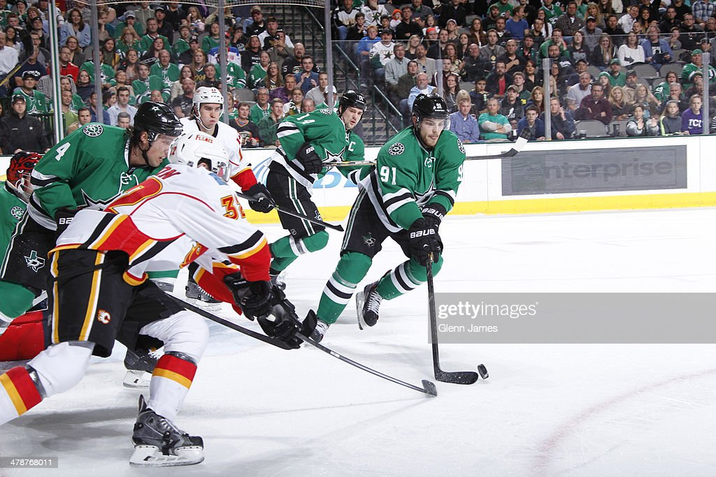 <a gi-track='captionPersonalityLinkClicked' href=/galleries/search?phrase=Tyler+Seguin&family=editorial&specificpeople=6698848 ng-click='$event.stopPropagation()'>Tyler Seguin</a> #91 of the Dallas Stars handles the puck against <a gi-track='captionPersonalityLinkClicked' href=/galleries/search?phrase=Paul+Byron+-+Ice+Hockey+Player&family=editorial&specificpeople=4535697 ng-click='$event.stopPropagation()'>Paul Byron</a> #32 of the Calgary Flames at the American Airlines Center on March 14, 2014 in Dallas, Texas.