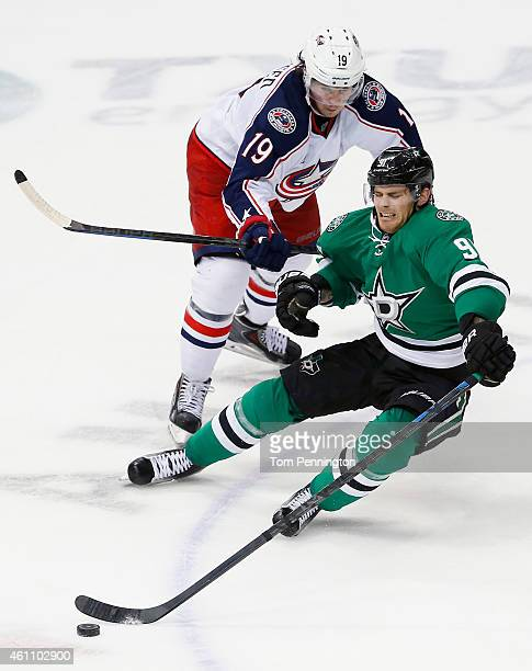 Tyler Seguin of the Dallas Stars is checked by Ryan Johansen of the Columbus Blue Jackets in the third period at American Airlines Center on January...
