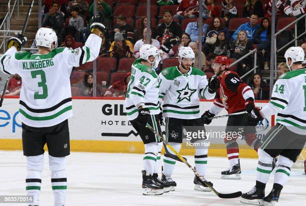 Tyler Seguin of the Dallas Stars is congratulated by teammates Alexander Radulov and Jamie Benn after his goal against the Arizona Coyotes as John...