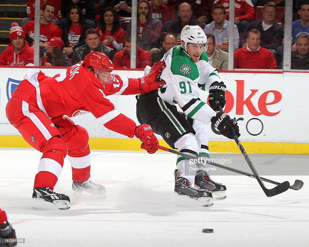 Tyler Seguin #91 of the Dallas Stars passes the puck as Pavel Datsyuk #13 of the Detroit Red Wings defends him during an NHL game at Joe Louis Arena on November 7, 2013 in Detroit, Michigan.