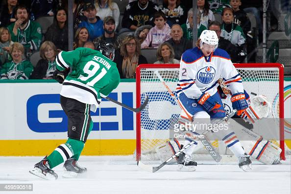 Tyler Seguin of the Dallas Stars rifles in a goal for his second of the game against Jeff Petry of the Edmonton Oilers at the American Airlines...